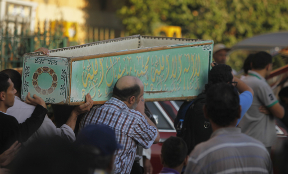 Egyptians carry the coffin of a Shi'ite victim, who was killed in sectarian violence, after funeral prayers in Cairo